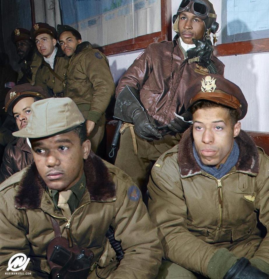 Tuskegee Airmen in pre-operation briefing over Anzio beachhead, Italy.